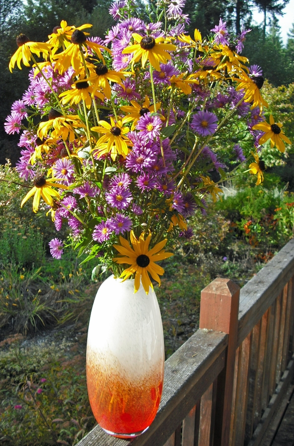 A beautiful arrangement of purple asters and yellow black-eyed susans