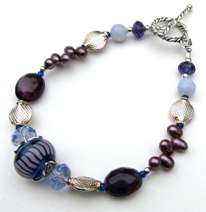 Bracelet of lampwork, amethyst, Swarovski crystal and sterling silver