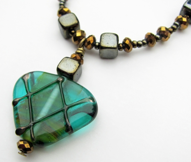 Bronze crystal necklace with teal colored lampwork pendant