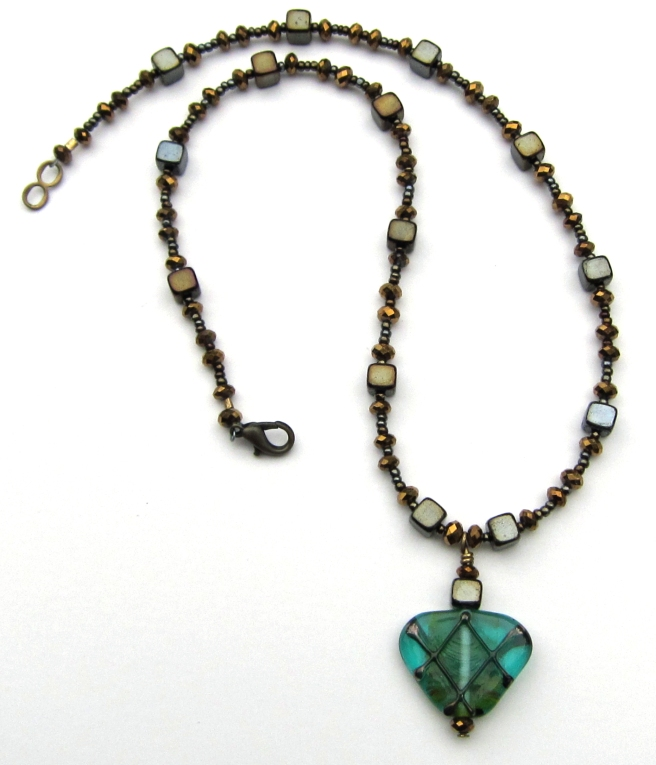 Bronzed crystal necklace with teal lampwork pendant