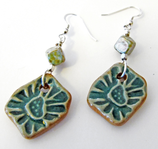 Ceramic earrings with radiant green heart designs
