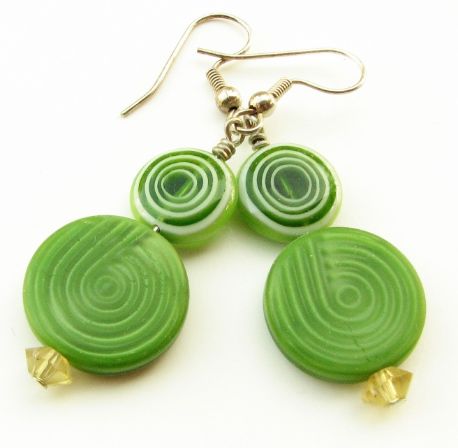Green swirl disc earrings