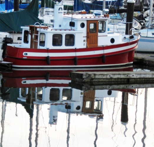 red tug boat by the dock