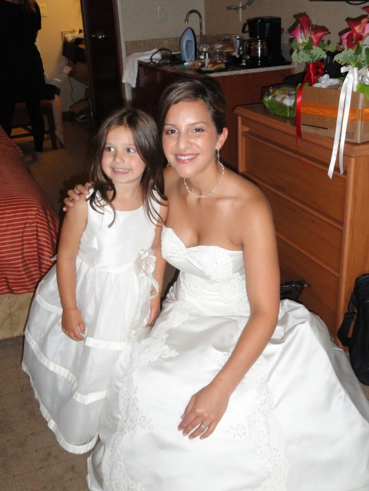 bride and flower girl with custom jewelry