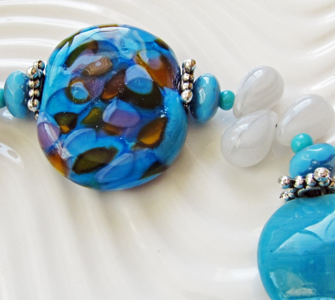 Turquoise speckled lampwork bead