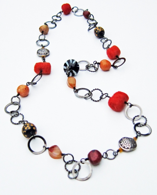 Gunmetal hand wired orange and black necklace