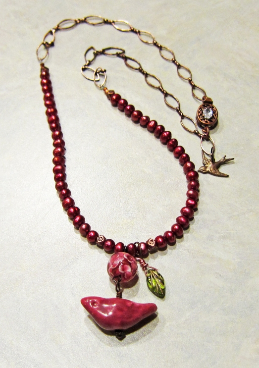 Pink bird necklace with pearls
