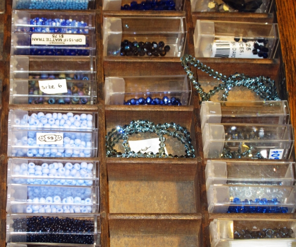 using a hamilton printers cabinet to organize seed bead, and crystals
