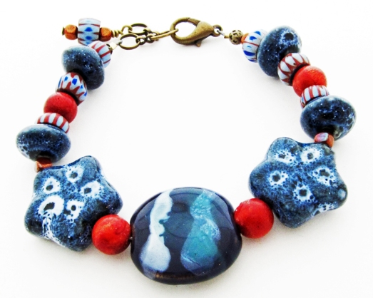 blue and red ceramic and coral bracelet