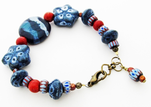 blue and red ceramic and coral bracelet, with Karzuri bead