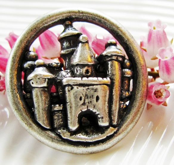 Metal button with castle design