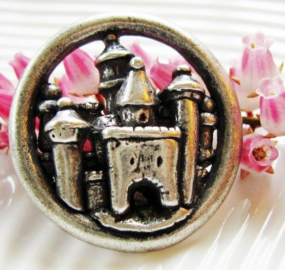 Metal button with castle design