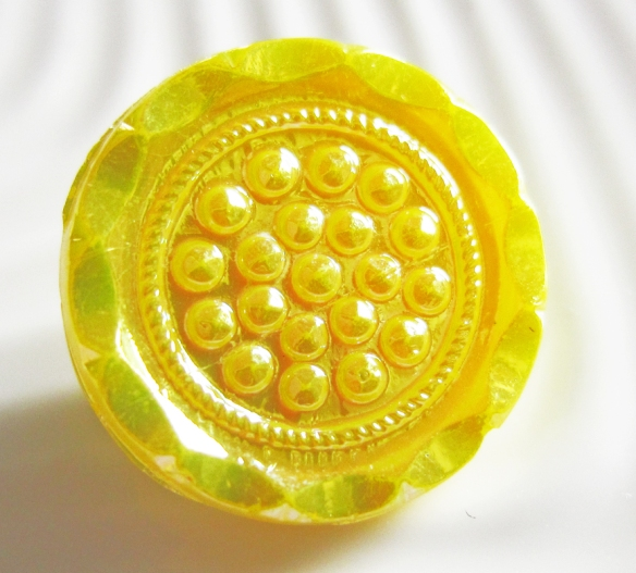 Textured, yellow German glass vintage button