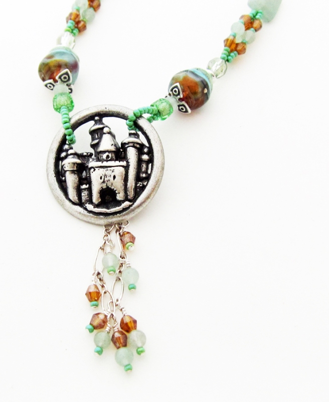 silver colored castle pendant with chain dangles