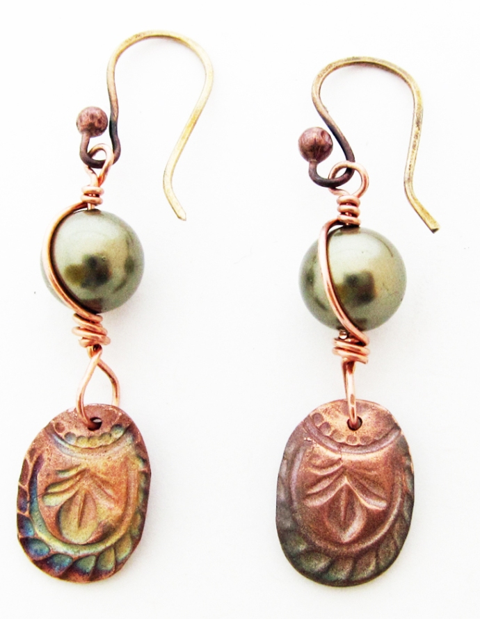 handmade earrings with sage green pearls and copper