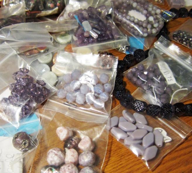 purple beads in ziplock baggies