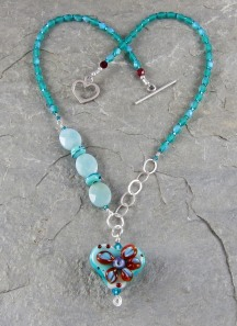 Handmade heart necklace of lampwork, amazonite, glass and sterling silver.