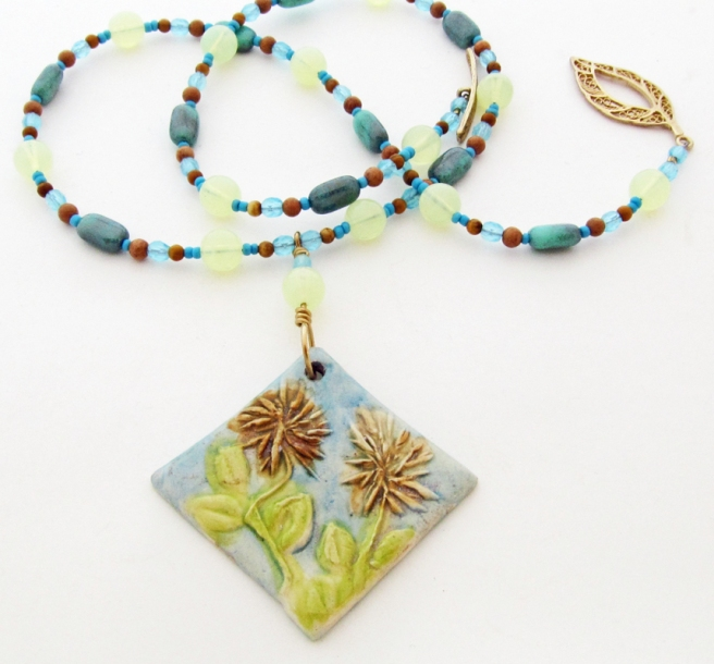 Ceramic Clay pendant with two flowers