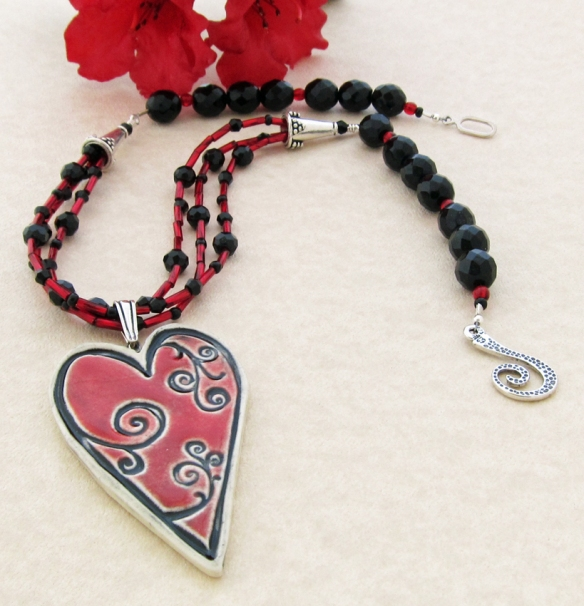 Red and black bead necklace with ceramic heart