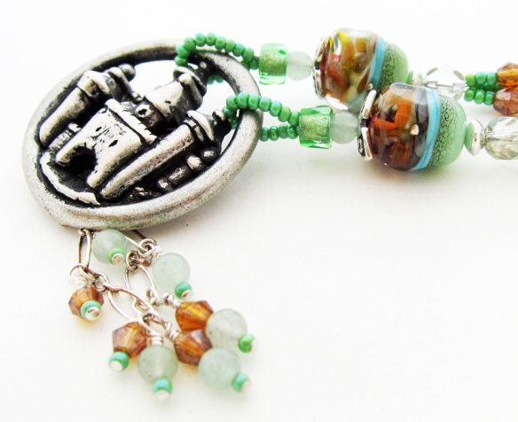 handmade necklace with castle pendant, lampwork glass and gemstones