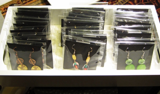 cellophane bags of earrings on display