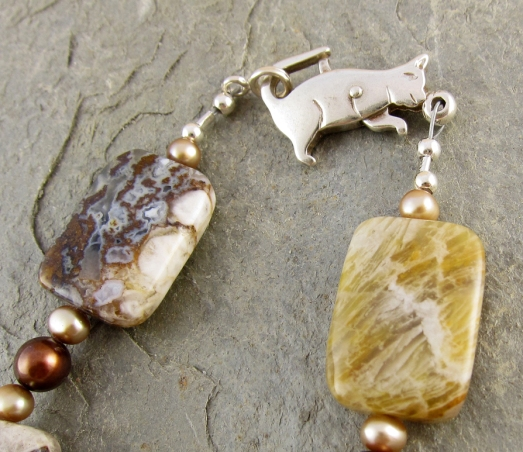 handmade bracelet, with sterling silver cat clasp, agates and pearls.