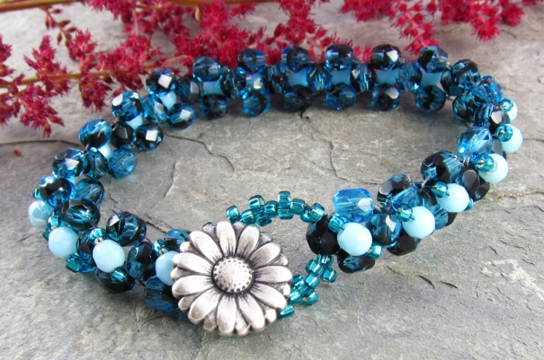 Turquoise hand woven bracelt with button clasp