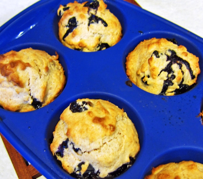 blueberry muffins in the tin