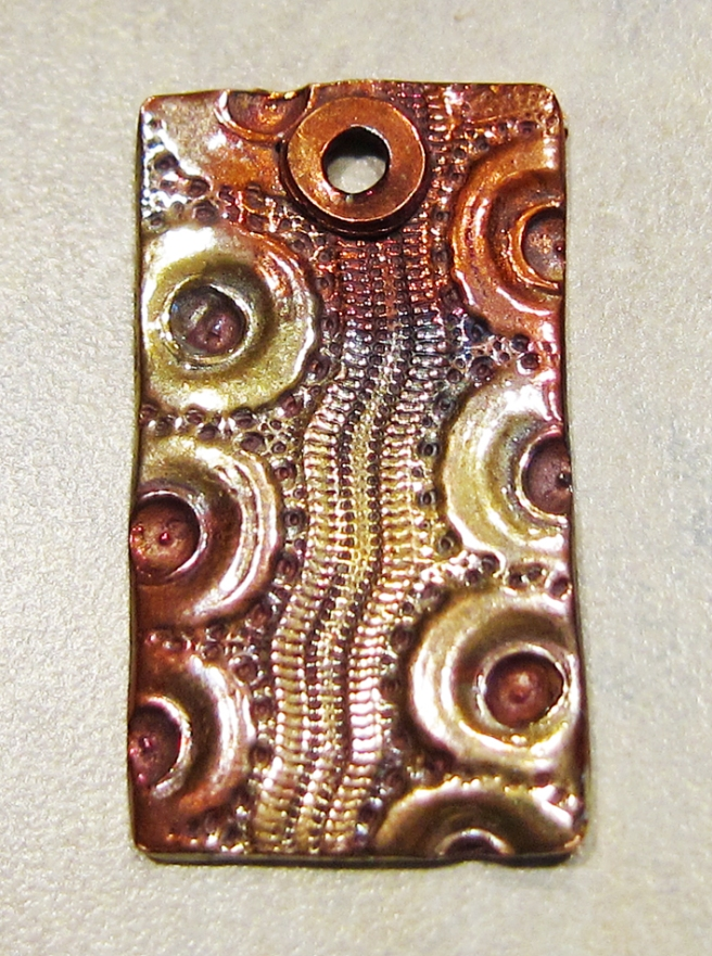 copper clay pendant with sea urchin pattern