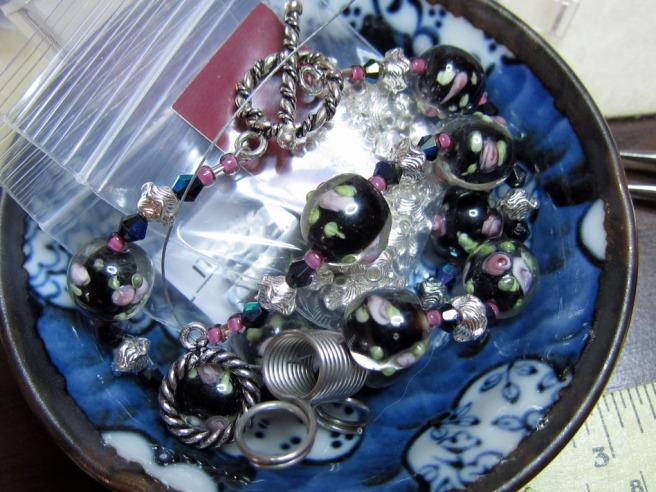 Black bracelets in a blue bowl