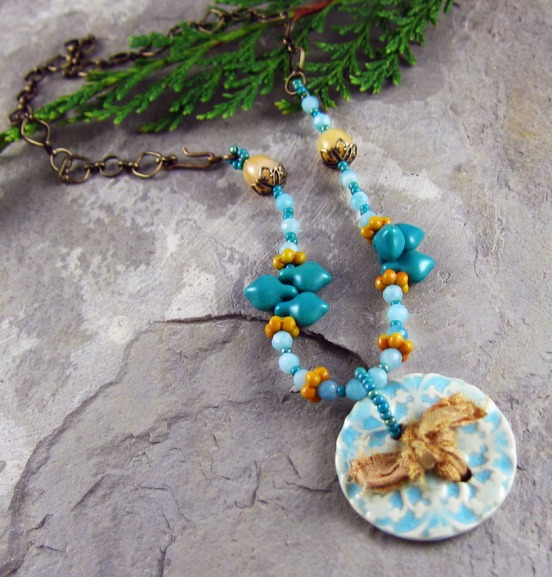 Handmade necklace by Linda Landig,with turquoise ceramic pendant