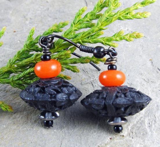 black and orange earrings.