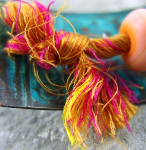 twisted orange and pink threads