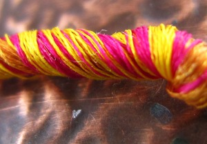 sari silk cord on copper