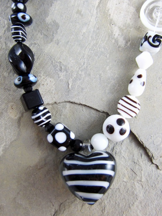 black and white glass bead necklace with a large glass heart