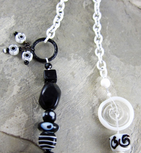 Black and white glass bead necklace with a large glass heart pendant