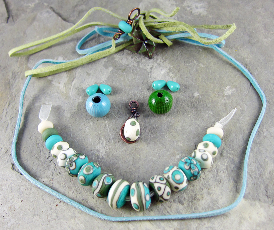 playful unique Turquoise necklace made of handmade glass beads turquoise lampwork necklace ceramic and howlite flower beads