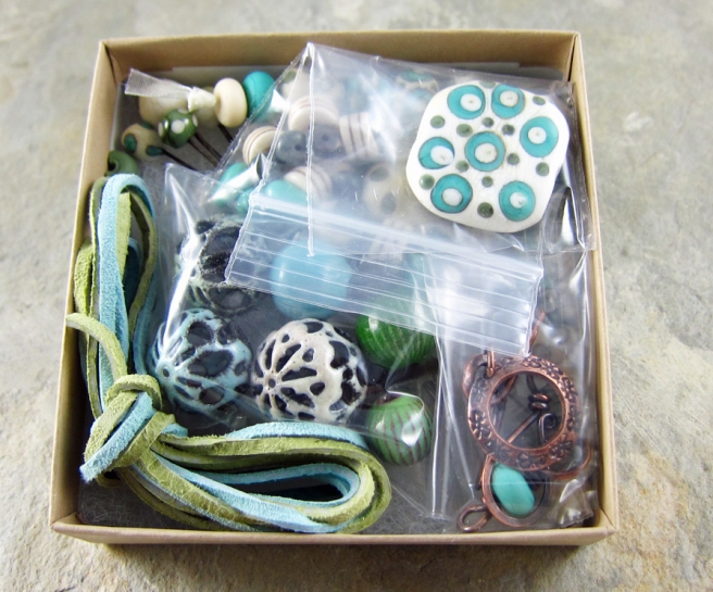 box of lampwork glass beads