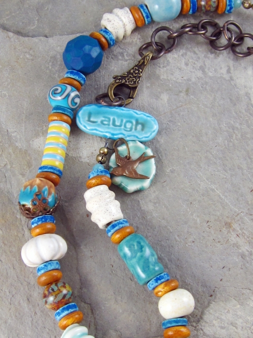 close up of clay beads in an artisan necklace