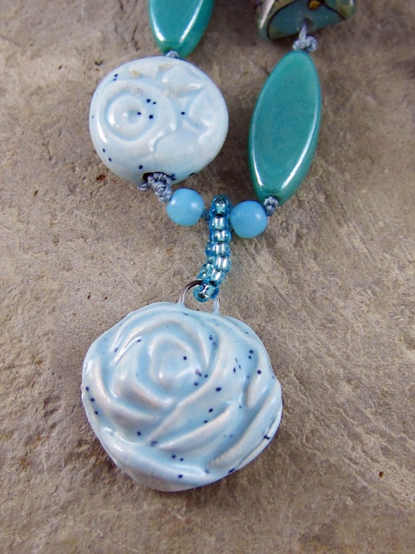 close up of artisan ceramic pendant and matching bead
