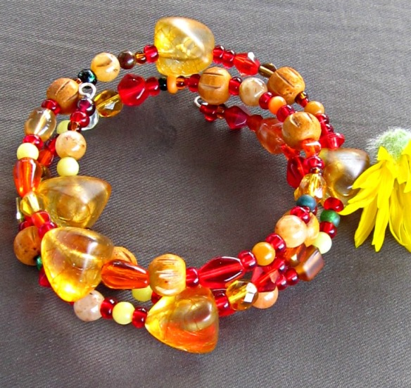 Red, gold and orange 3 strand memory wire bracelet