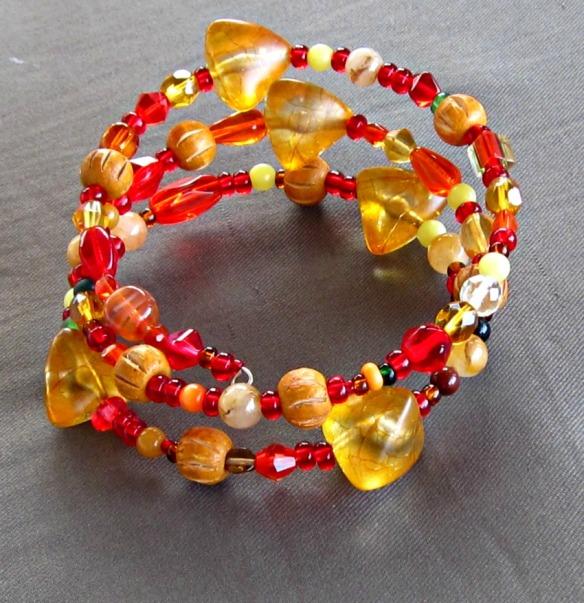 red, gold and orange 3 strand bracelet.