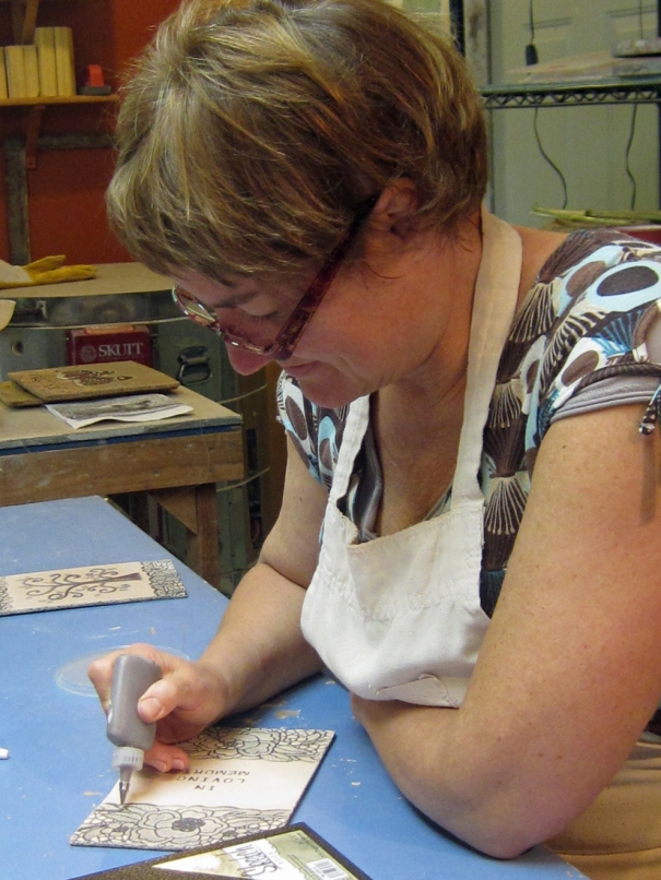 Marion at work on one of her custom stoneware book covers.