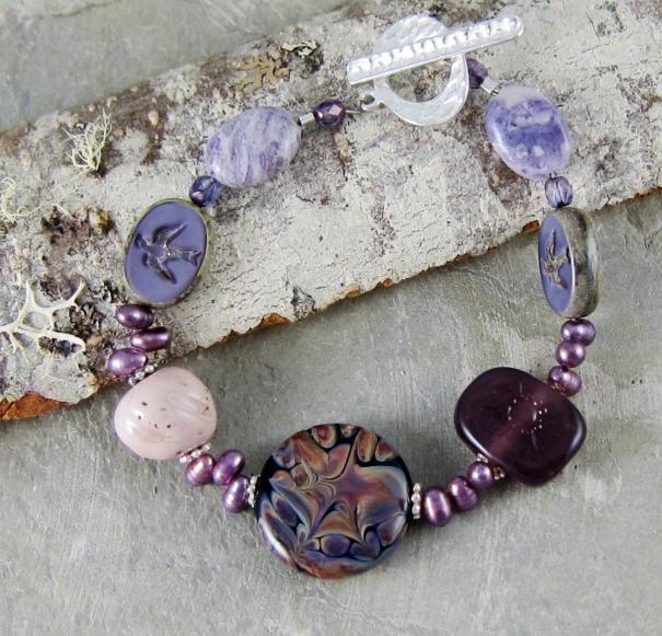 Purple lampwork bracelet by Linda Landig Jewelry