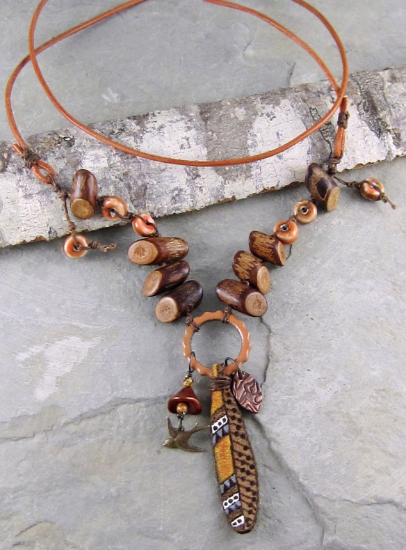 Handmade leather feather necklace by Linda Landig Jewelry