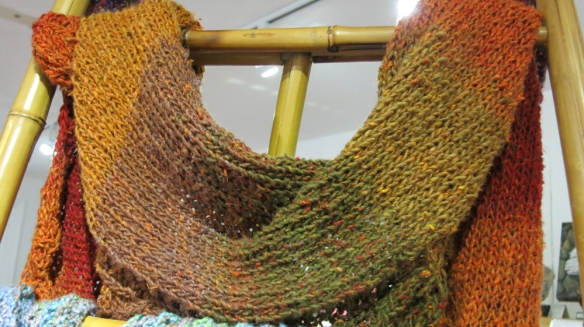 Swoon! My favorite colors are featured in this knitted scarf.